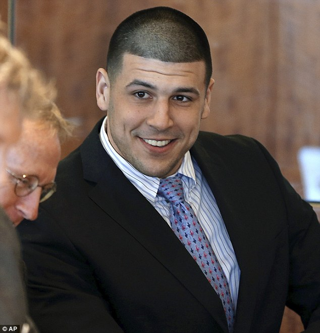 Violet skirmish: Former New England Patriots football player Aaron Hernandez allegedly beat up another inmate in a Massachusetts jail