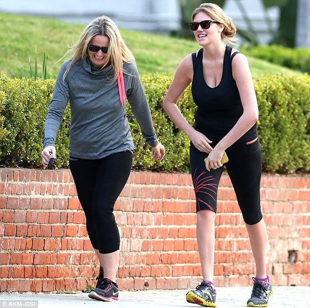 Out for some exercise: The pals chatted and giggled as they went on their way