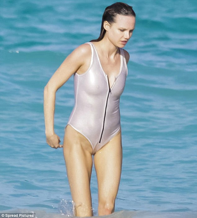 Marvellous in metallic: Alicia changed into a silver swimsuit for another point in the shoot