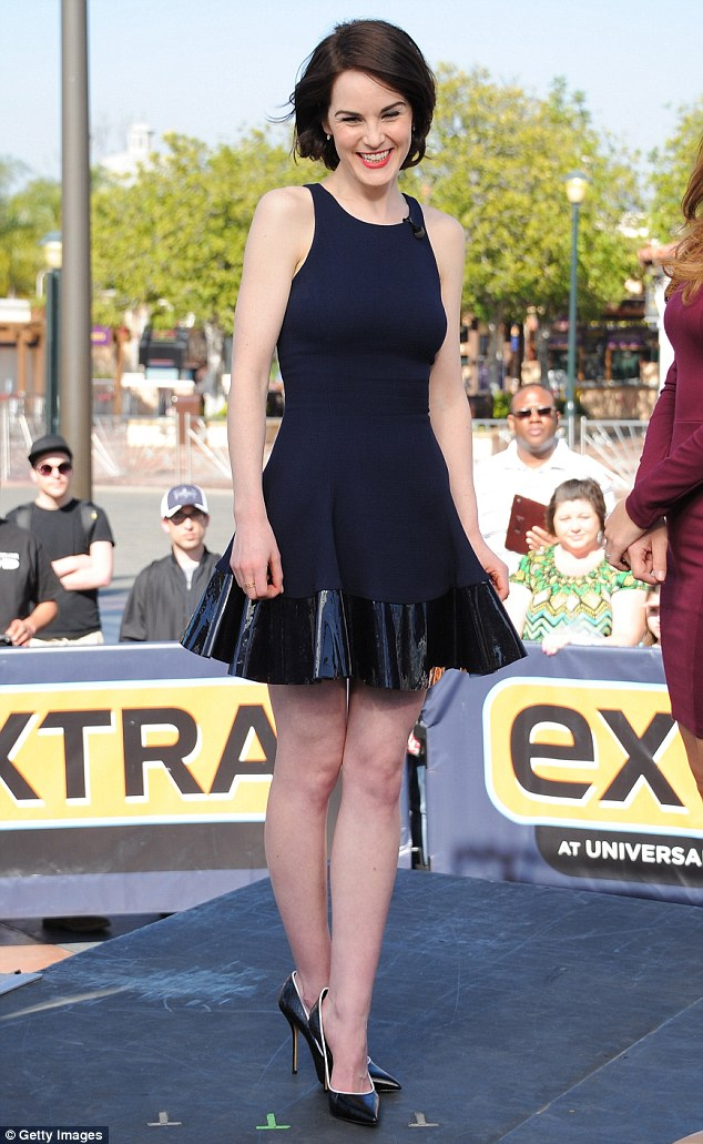 Looking trim: Michelle Dockery started a day of promotional appearances in a pair of high-heeled black court shoes, which she teamed with a thigh-skimming navy dress for an interview about her latest film