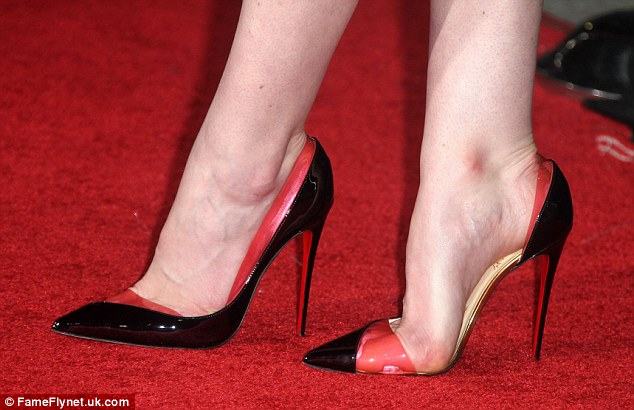 The only way is up! Michelle Dockery's heels just kept rising as she promoted her new film starring Liam Neeson