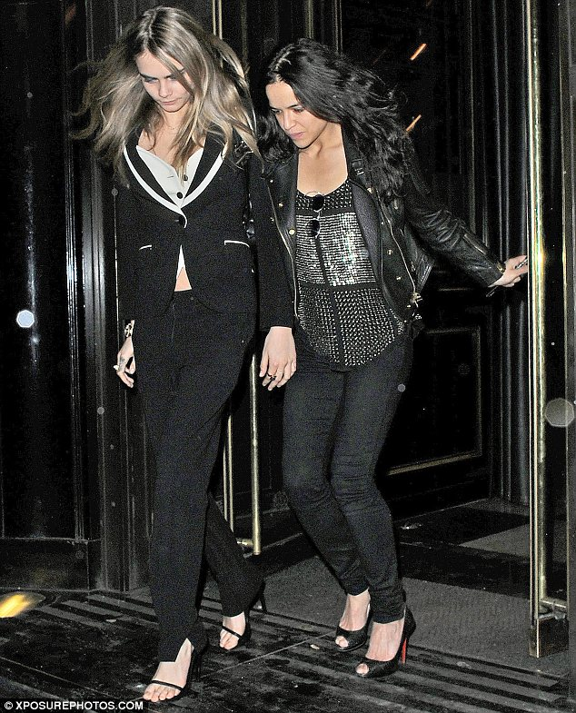 Inseparable: Before jetting to Italy Cara, 21, and 35-year-old Michelle were seen out on the town in London
