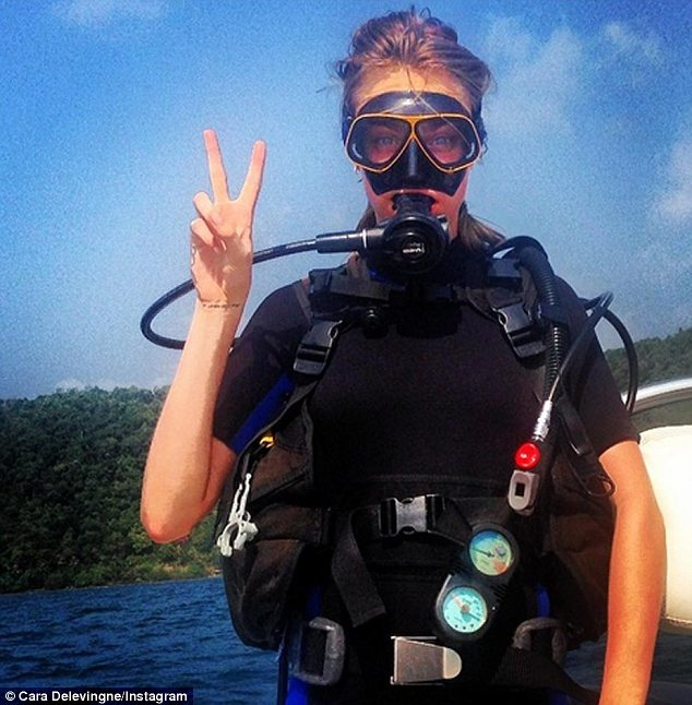 Romantic getaway: It seems Michelle's girlfriend Cara Delevingne might be on the Thailand holiday too as that same day she shared a photo of herself wearing scuba diving gear while in a tropical location