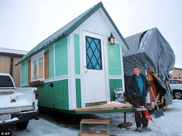 Betty Ybarra, 48, stands outside a tiny house she and her boyfriend live in, in Madison, Wisconsin. It is the first house built by OM Build, which wants to build nine houses in Madison for the homeless