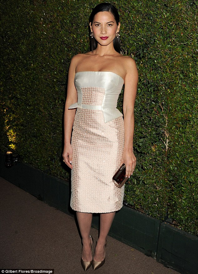 Who needs a watch when your style is timeless? Olivia Munn stuns at the Bvlgari Decades Of Glamour party