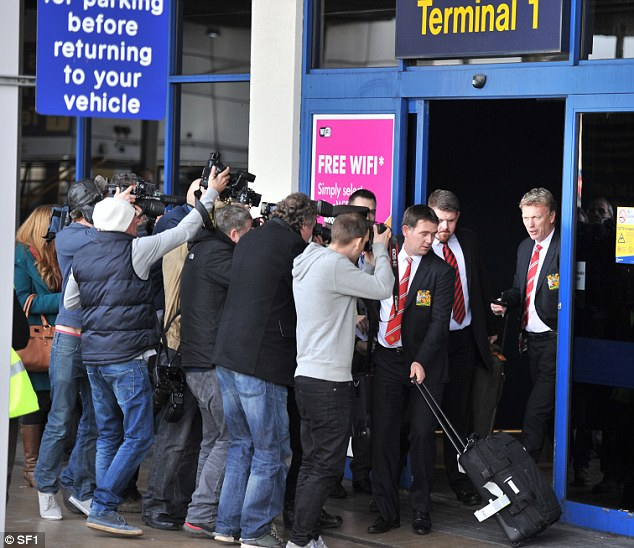 In focus: David Moyes returned to Manchester on Wednesday afternoon under increasing pressure following the defeat to Olympiakos