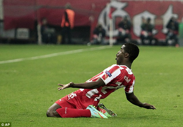 Hero: Joel Campbell celebrates scoring Olympiakos' second goal in Tuesday's win against United