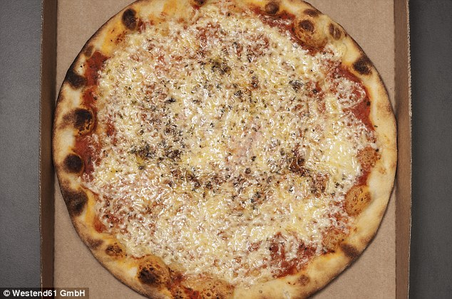 Daily diet: The pizza-addict usually consumes two 14-inch rounds every day washed down with coffee
