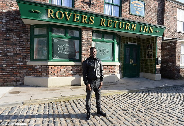 Iconic setting: Kevin poses outside the legendary Rovers Returns