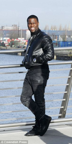 Statuesque: The actor cuts a striking figure as he poses outside the Manchester studios