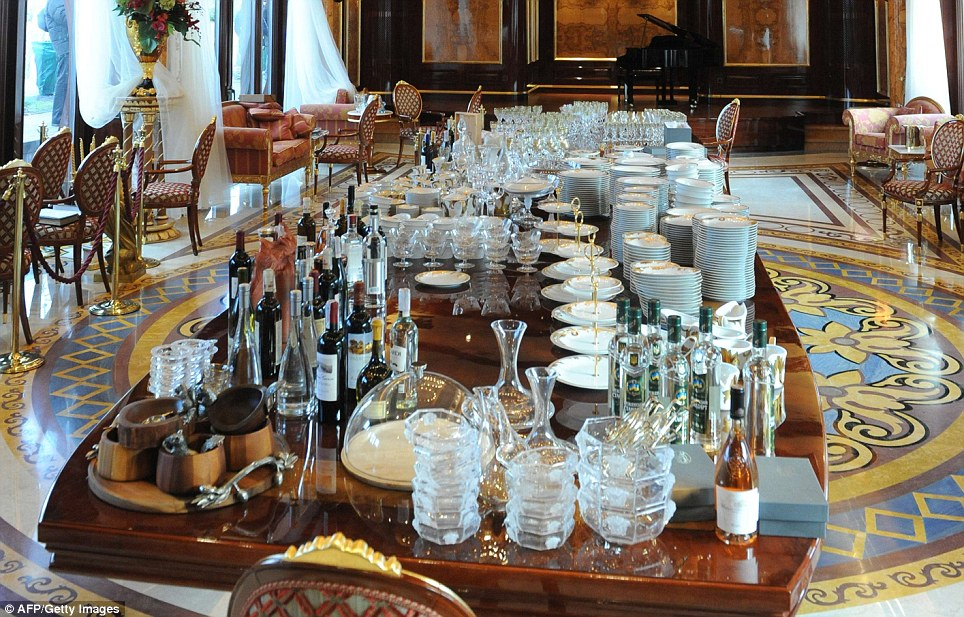 Fine dining: Bottles of wine and spirits and elaborate glassware and tableware