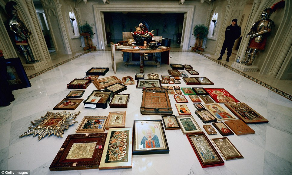 Elaborate: Religious iconography is laid out on the floor, flanked by burnished suits of armour