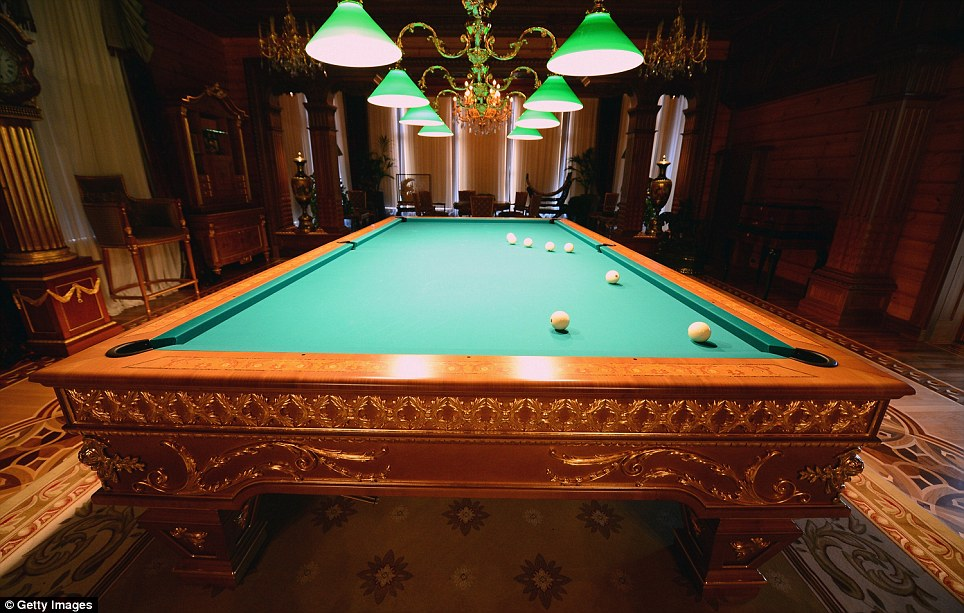 Sumptuous: Balls are left on a finely-crafted billiards table, as if the game was left unfinished