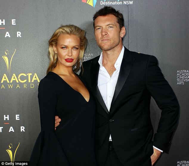 Are they? The scuffle fueled rumors the couple are married after Worthington called Bingle 'my wife' in the chaos. He was also pictured wearing a wedding ring to court on Wednesday