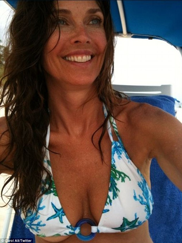 She's still got it: Carol shared a sexy snapshot of herself spilling out of a bikini top on Twitter in 2012
