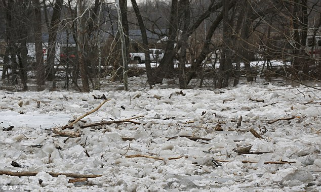 An ice jam causes Wildcat Creek to flood  in Lafayette, Indiana this weekend. Residents along Barton Beach Road, on the opposite side of Wildcat Creek, were evacuated after flood waters surrounded their homes