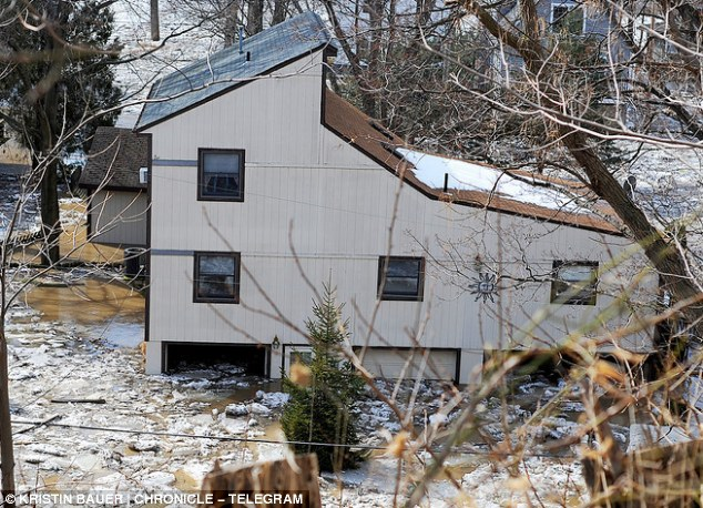The homes along Riverside Drive, in Vermilion, Ohio flooded this weekend after huge ice jams caused the river to burst its banks