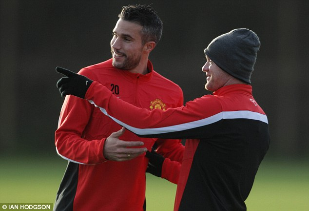 Double act: United manager David Moyes and the club's board are determined that Van Persie and Wayne Rooney will spearhead the club's frontline next season