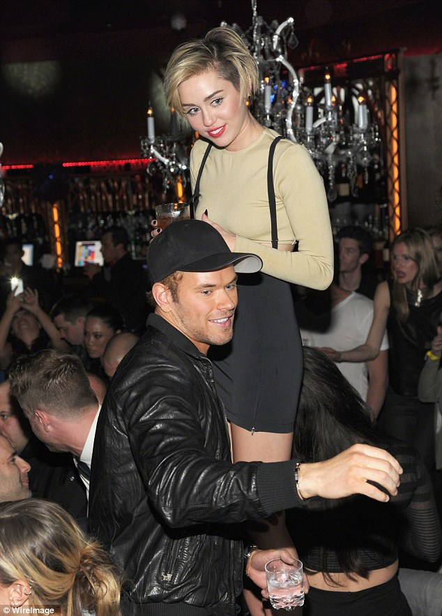 Achy breaky heart: Just two months ago, the 28-year-old was seen working his magic on Miley Cyrus as she opened Beacher's Madhouse nightclub in Las Vegas, Nevada