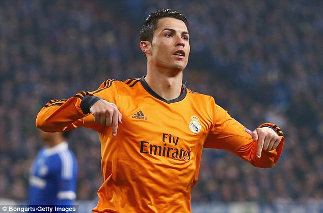 I'm the man: Ronaldo celebrates after blasting home Real Madrid's third goal of the night