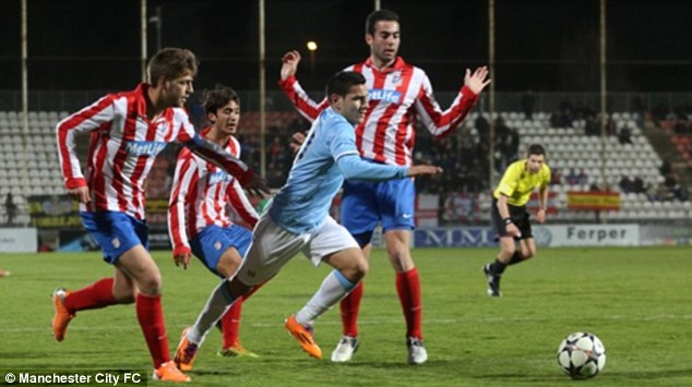 Evasive: Marcos Lopes escapes the attention of three Atletico players