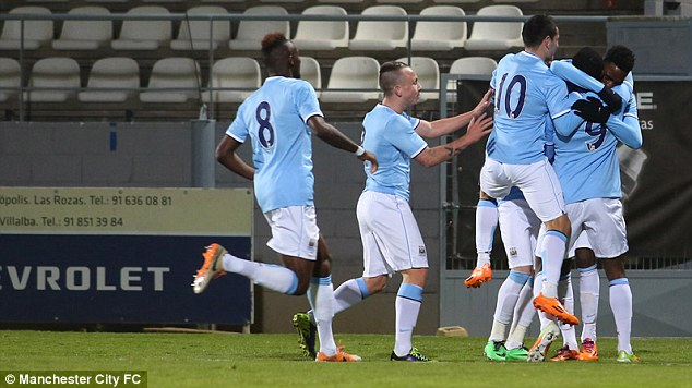 Mobbed: Devante Cole (No 9) is congratulated by City team-mates after scoring his goal