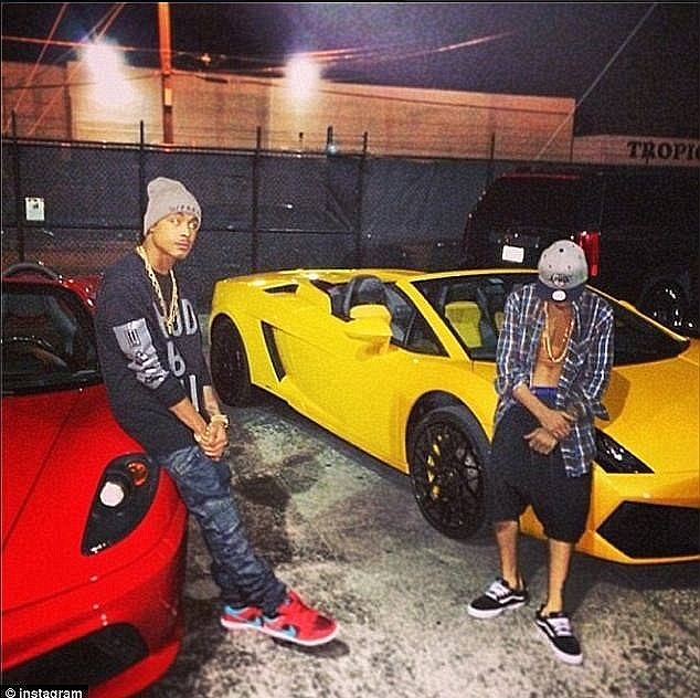 Fast and furious: The singer, right, was caught drag-racing through a residential area in his yellow Lamborghini