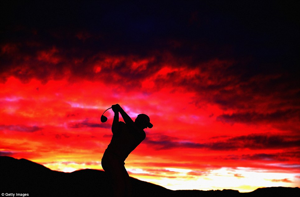 Red sky at night: Michael Hendry of New Zealand warms up on the driving range before round one of the New Zealand Open at the Millbrook Resort