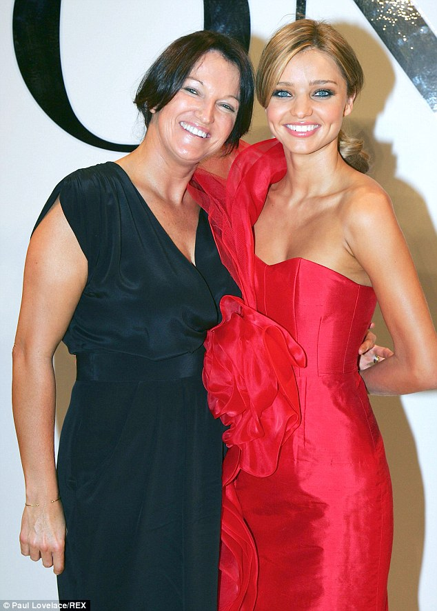 No worries: Supermodel Miranda Kerr (right) and her mother Therese have denied claims they have had a falling out, with Therese saying she just wants to step out of her daughter's shadow. The pair are pictured at the David Jones Spring/Summer 2009 Fashion Show in Sydney