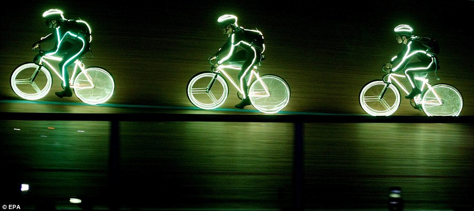 See the light: Cyclists with neon costumes participate in the opening of the World Competition of Track Cycling in Cali, Colombia