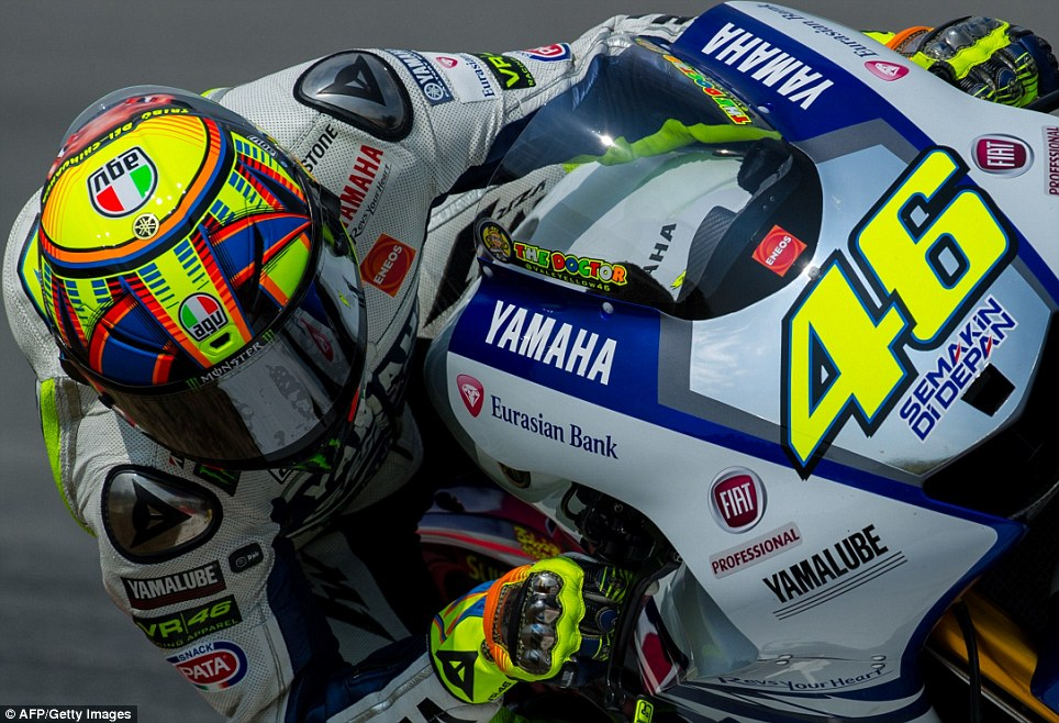 Round the bend: Yamaha Factory Racing and legendary world champion Valentino Rossi during the second day of the second MotoGP pre-season test at the Sepang circuit