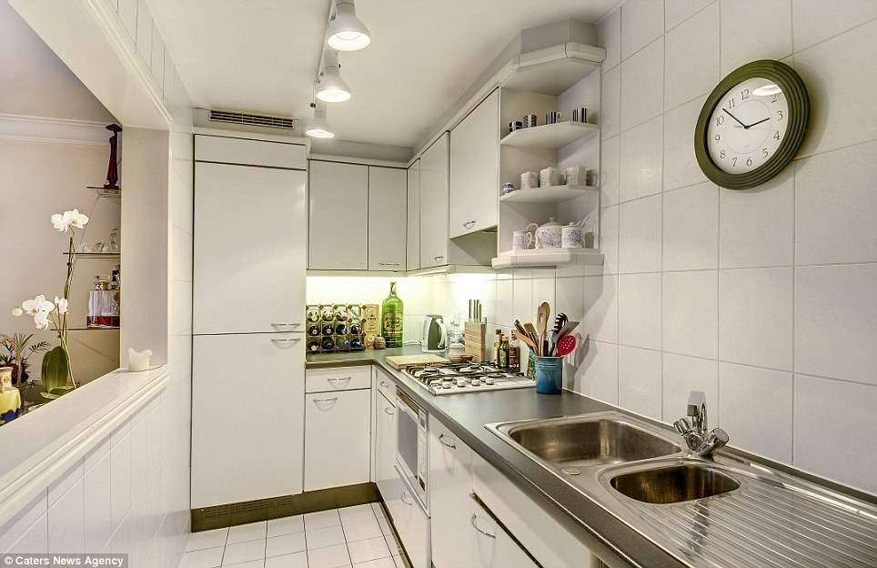 Bit of a squeeze: The kitchen in the Covent Garden flat is a little on the small side, sacrificing the space of the kitchen for having a more open plan living room