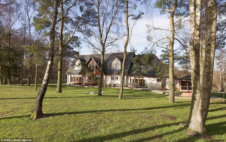 Larch cottage in Scotland also boasts a small wooded area to the rear of the property, as well as a bird cage and several acres of land, which can be used for activities or simply used for the views