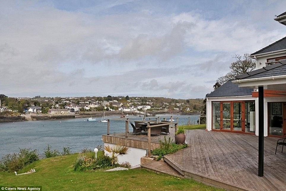 The property also features a large garden and deck that looks out over a harbour near Anglesey, perfect for barbeques and evenings spent with friends and family. The deck also features a snug covered area for warm but rainy days
