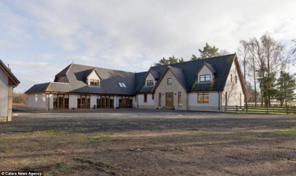 The Scottish cottage is a newer build that attempts to capture a flair of old-style design, and has heavy emphasis on recreation and entertainment rooms. Much of the land has been newly built on, and the drive has likely been surfaced to fit several cars without destroying the land or creating potholes