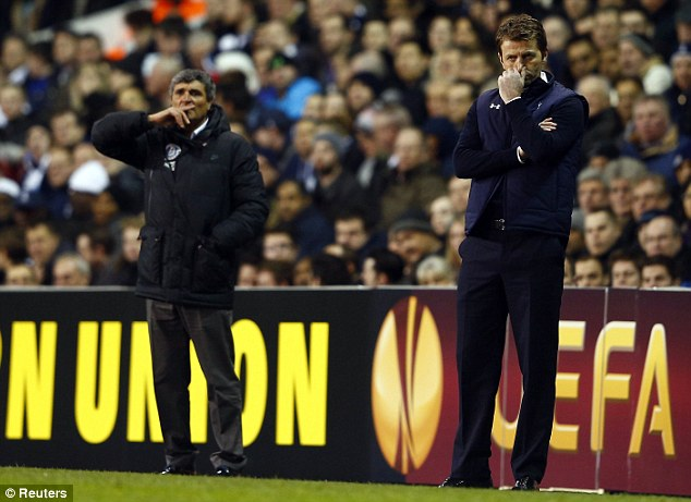 Nervy moments: Both managers observe proceedings from the touchline on a breathless night