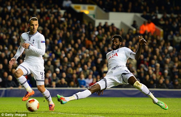 Clinical finish: Adebayor fires home from close range to put Spurs ahead on the night