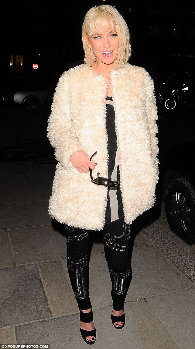I've got my eye on you: Sarah removed her glasses to have her picture taken outside a private members club in Mayfair