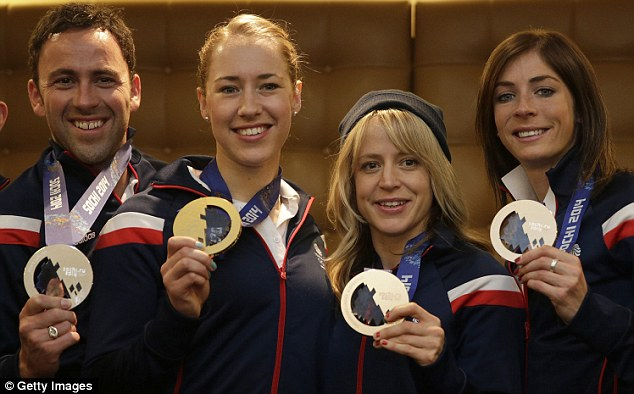 National pride: David Murdoch (left), Yarnold (second left), Jenny Jones (second right) and Muirhead show off their medals following Sochi