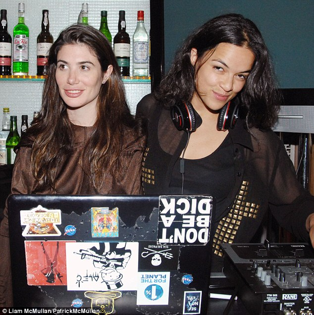 Ex-lovers: Michelle Rodriguez iis said to have dated flimmaker Francesca de Sola. The pair are pictured at the screening of Francesca's film 1%ers in New York in April 2013