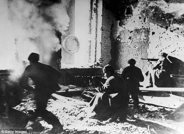 The real battle: Russian soldiers target Germans from within an abandoned building during the 1942 conflict