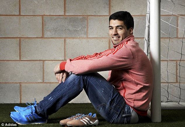 All smiles: Suarez is looking forward to wearing the boot for the first time next month