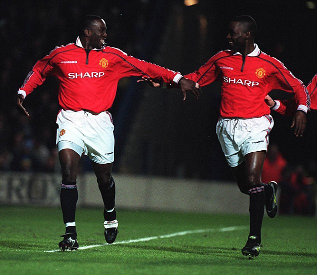 Double act: Dwight Yorke celebrates his goal with Andy Cole as the pair fire United to the Treble in 1999