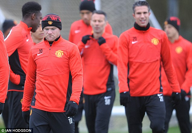 Distant: Rooney and Van Persie are struggling to find the magic in their partnership