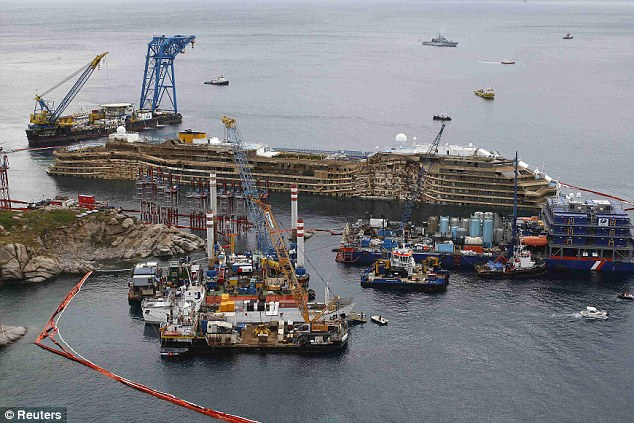 Salvage operation: The Costa Concordia after it was raised upright in September in the biggest salvage operation of its kind. It is due to be towed away for scrapping in June
