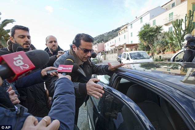 Media scrum: Schettino arrives for a briefing prior to boarding the wreck of the Costa Concordia