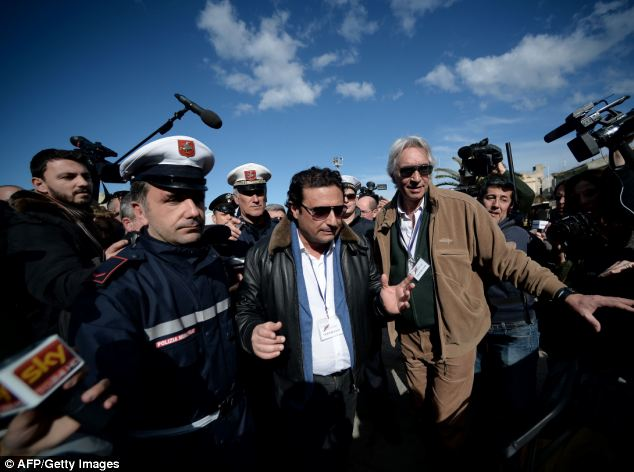 Anger: The former captain of the Costa Concordia faced an angry mob, with one local shouting: 'Drown yourself'
