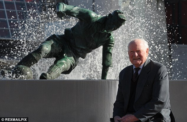 making a splash: Finney next to the statue of him outside Deepdale, taken from this iconic photo (below)