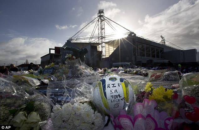 Tribute: Flowers and a football are laid outside Deepdale in memory of Finney