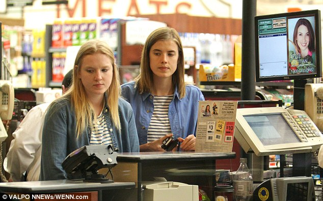 Copy cat!The 31-year-old appeared to be wearing an almost identical outfit to her female companion, which included a denim shirt and stripey white and navy top